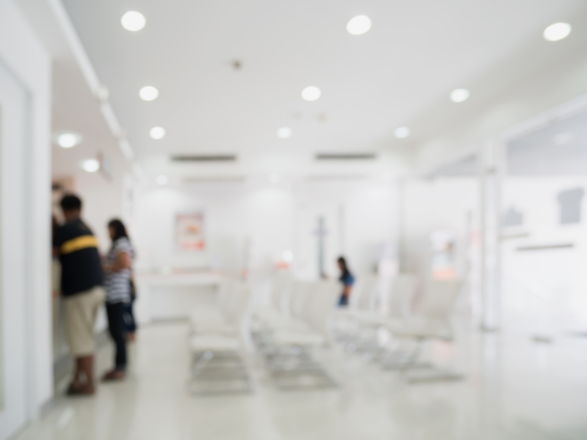 Blur abstract hospital interior background with customer or patients at counter