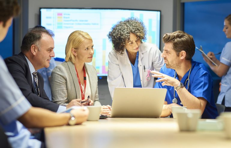 hospital management discussing a healthcare merger and acquisition